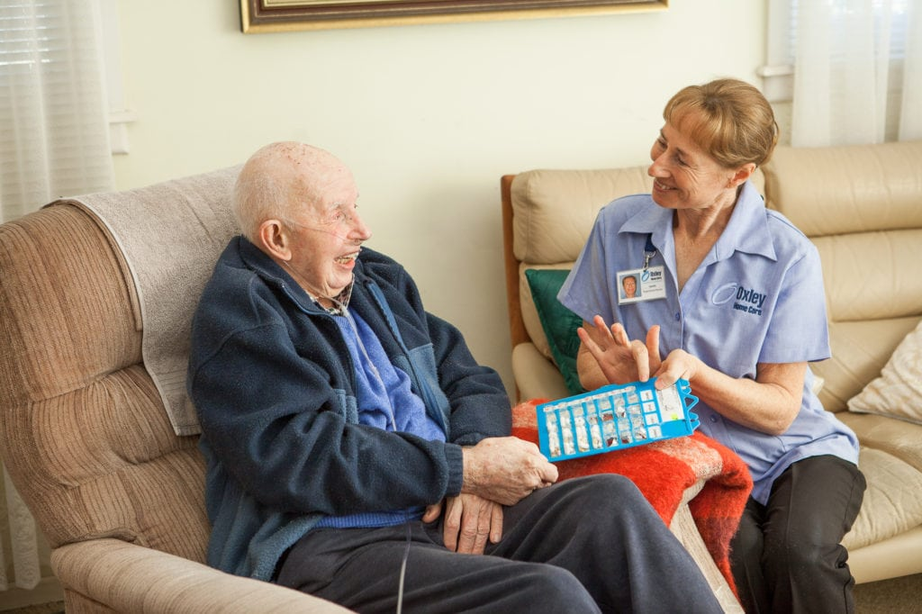 RN providing in home nursing care to an Oxley Home Care client
