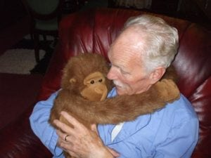 Man with orangutan - Oxley Home Care