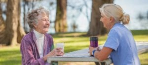 Carer and client having coffee