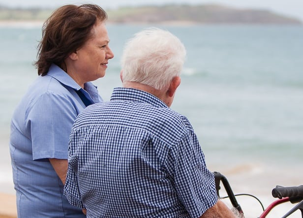Carer and client at beach