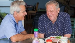 Carer and client having lunch