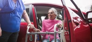 Ensuring safe transfer of an elderly person from a car.