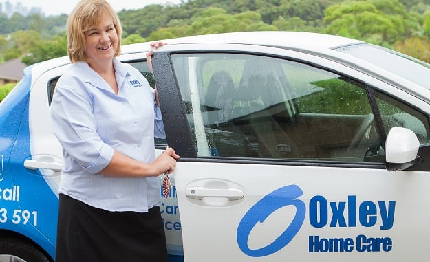Home Care Package, Oxley Home Care Manager beside car