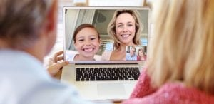 Home Care Packages, Image of people using Facetime to communicate