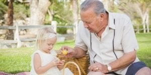 Living at home, grand-father celebrating Easter with his grand-daughter, Oxley Home Care